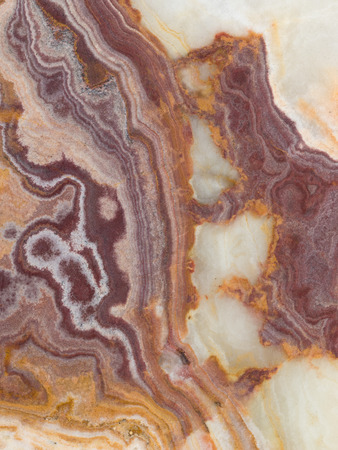 black onyx: beautiful onyx with dark brown, red and beige stains and streaks in a large heavy slab Stock Photo