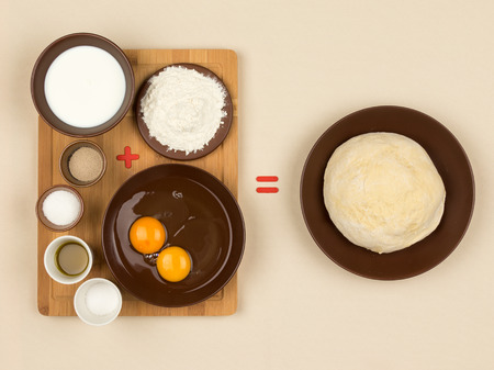 sign equals: yeast dough and eggs, milk, flour, yeast and other Ingredients for making dough and red plus signs, and equal to the beige cloth tablecloths Stock Photo