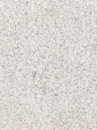 slab: light speckled granite stone with small patches in the slab