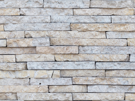 old wall of marble beige with pink stone, stacked like bricks