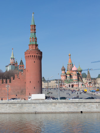sights of moscow: Moscow - April 12, 2015: Many citizens and tourists walk on Vasilevsky descent and admire the sights of the Kremlin and St. Basils Cathedral April 12, 2015, Moscow, Russia
