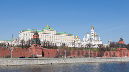 Moscow - April 12, 2015: Kremlin Embankment on a sunny day in early spring, people walking and cars go along the Kremlin walls and see the architectural ensemble of the Moscow Kremlin April 12, 2015, Moscow, Russia
