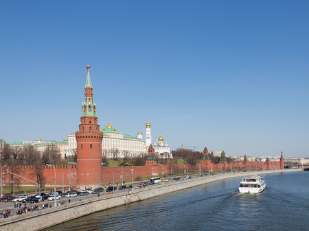 dovetail: Moscow - April 12, 2015: A view of the Kremlin embankment in Moscow and visible architectural ensemble of the Moscow Kremlin and the tourists go on the ship April 12, 2015, Moscow, Russia