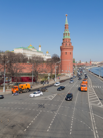 dovetail: Moscow - April 12, 2015: View of the beautiful Kremlin embankment in Moscow, people walk and ride atomobili in good weather in early spring April 12, 2015, Moscow, Russia