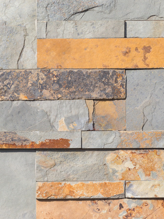 displacement: Wall from natural brown, ocher and gray stone laid as a brick Stock Photo