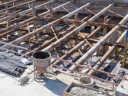 strong base: post-and-beam system with metal beams and concrete pillars at a construction site Stock Photo