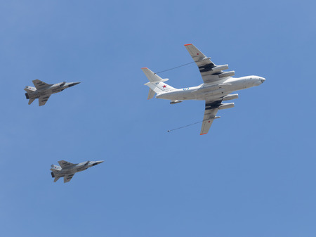 seventieth: Moscow - May 7th, 2015: Powerful military planes imitate steam aerial refueling over Red Square in honor of the seventieth shall meet you in the Great Patriotic War Victory Day parade rehearsal on May 7th, 2015, Moscow, Russia Editorial