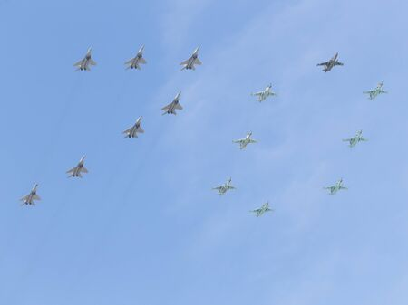 seventieth: Moscow - May 7th, 2015: Military aircraft painted in the sky figure 70 in honor of the seventieth anniversary over fascism shall meet you at the rehearsal of the Victory Parade on the background of blue sky May 7, 2015, Moscow, Russia