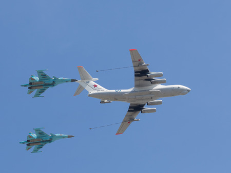 seventieth: Moscow - May 7th, 2015: Military planes mimic pair aerial refueling over Red Square in honor of the seventieth birthday of fascism shall meet you at the rehearsal of the Victory Parade on the background of blue sky May 7, 2015, Moscow, Russia Editorial