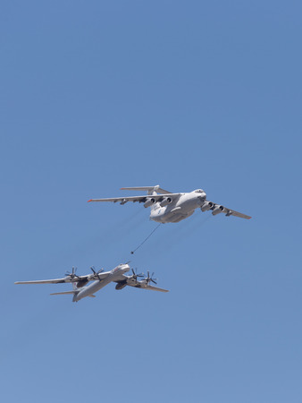 midas: Moscow - May 7th, 2015: the plane Il-78 Tu-95MC runs fuel against a blue sky with clouds May 7, 2015, Moscow, Russia