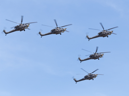 may fly: Moscow - May 7th, 2015: five military helicopters Mi-28NE fly formation against a blue sky 7, 2015, Moscow, Russia