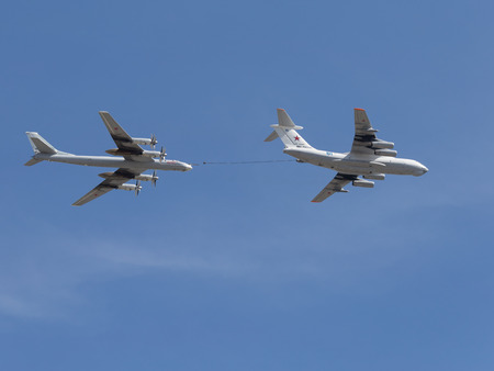 Moscow - May 7th, 2015: Tu-95MC planes and Il-78 aerial refueling show on a background of blue sky with clouds May 7, 2015, Moscow, Russia