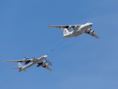 midas: Moscow - May 7th, 2015: Tu-95MC planes and Il-78 flying one behind the other on a background of blue sky with clouds May 7, 2015, Moscow, Russia Editorial