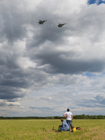 military watch: Moscow Region - June 17, 2015: People watch flight of military aircraft at the international military-technical forum Army 2015 at the airfield Kubinka June 17, 2015, Moscow Region, Russia