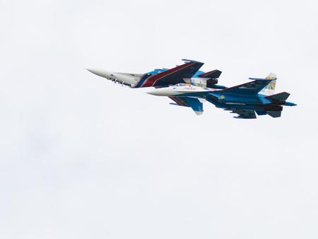 aerobatics: Moscow Region - June 17, 2015: Military aircraft aerobatic team Russian Knights aerobatics performed mirror on the International Military-Technical Forum ARMY-2015 June 17, 2015, Moscow Region, Russia Editorial