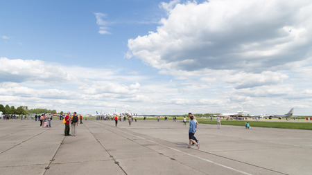 airfield: Moscow Region - June 17, 2015: A lot of people come to the airfield Kubinka the exhibition Army 2015 June 17, 2015, Moscow Region, Russia Editorial