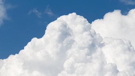 photons: beautiful big white cumulus clouds against a bright blue sky
