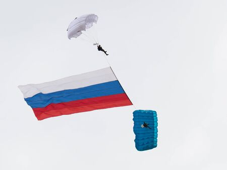 airshow: Moscow Region - June 17, 2015: Two military parachutist fly in the sky with the flag of Russia on the international airshow on military-technical forum ARMY-2015 June 17, 2015, Moscow Region, Russia