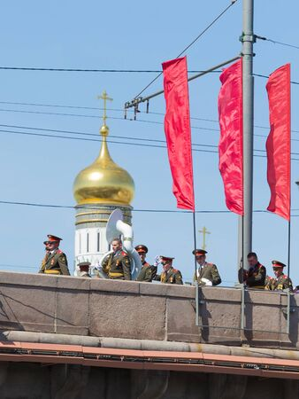 rehearsal: Moscow - May 7th, 2015: Military musicians are on the Moscow River bridge after a rehearsal for the Victory Day parade and see the golden dome of the Ivan the Great Bell May 7, 2015, Moscow, Russia