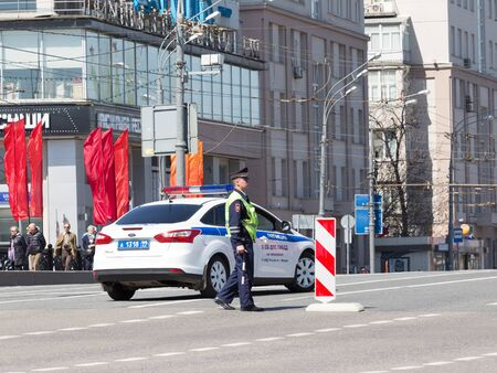 wheel house: Moscow - May 7, 2015: The guard and the police patrol car on a city street May 7, 2015, Moscow, Russia