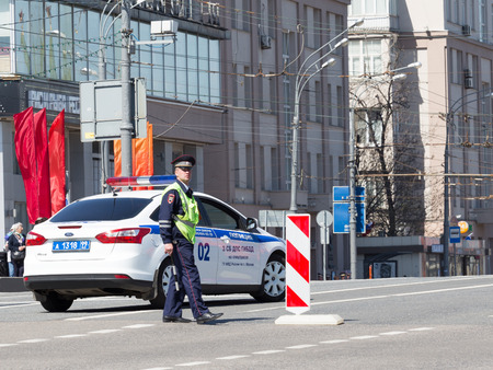 patrol car: Moscow - May 7, 2015: The guard policeman centuries and form a patrol car on a city street May 7, 2015, Moscow, Russia