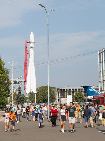 vostok: Moscow - August 13, 2015: People walk at the Exhibition Centre to take in the sights and space rocket Vostok in which Yuri Gagarin flew August 13, 2015, Moscow, Russia Editorial