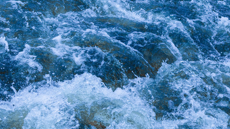 seething: clear blue water flows bubbling and splashing splashing splashes and drops Stock Photo