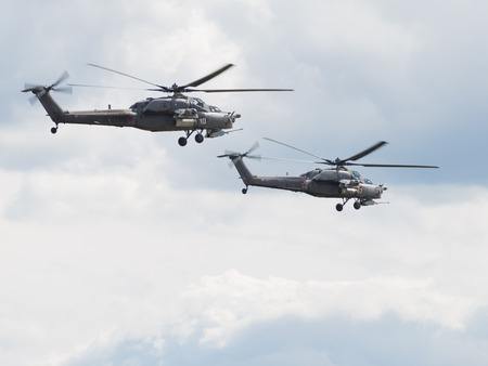 air demonstration: Moscow Region - June 17, 2015, two Russian military helicopter Mi-28 to make a demonstration flight at an air show demonstrations Kubinka June 17, 2015 Moscow region, Russia