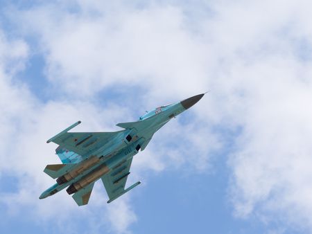 modern fighter: Moscow Region - June 17, 2015: Flight of a new Russian fighter-bombers Su-34 demonstrations at air shows in Kubinka June 17, 2015 Moscow region, Russia