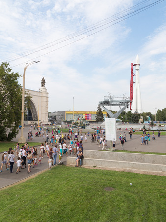 vostok: Moscow - August 13, 2015: People walk on exhibitions and visible space rocket Vostok in which Yuri Gagarin flew August 13, 2015, Moscow, Russia
