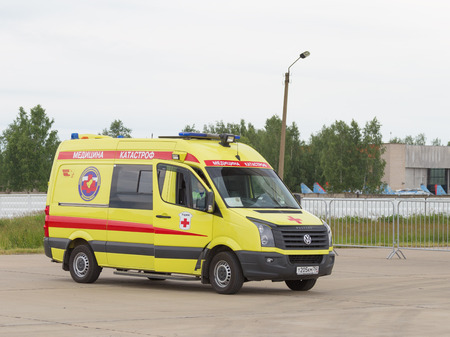 paramedics: The Moscow region - 19 June 2015: The machine disaster medicine with paramedics on duty at the airport Kubinka during conduct demonstrations of aerobatic teams June 19, 2015, Moscow Region, Russia