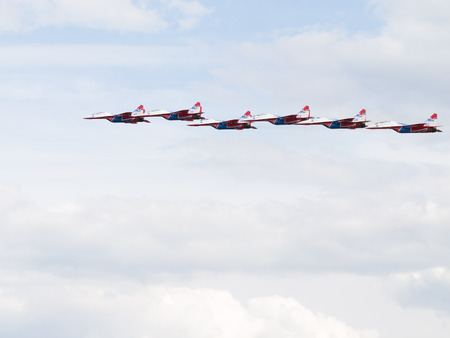 aerobatics: The Moscow region - 17 June 2015: Russian Aerobatic team Swifts and six MiG-29, flying high into the sky to show aerobatics 17 June 2015, Moscow Region, Russia
