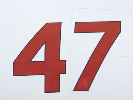 forty: bright red number forty seven painted with paint on metal Stock Photo