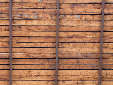 crossbars: old wooden ceiling boards and crossbars on the veranda outside Stock Photo