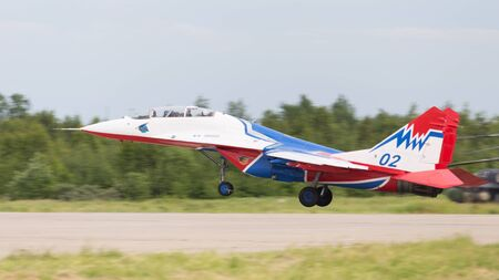 aerobatic: The Moscow region - 17 June 2015: The aircraft MiG-29 Swifts aerobatic team is landing June 17, 2015, Moscow Region, Russia Editorial
