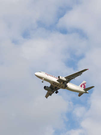spar: Moscow - August 6, 2015: A passenger plane Airbus A320-232 Qatar Airways landing at Domodedovo airport in good weather August 6, 2015, Moscow, Russia Editorial