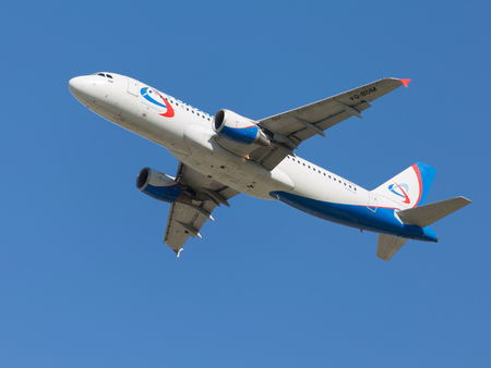 spar: Moscow - August 6, 2015: Beautiful passenger Airbus A320-214, Ural Airlines takes off at Domodedovo airport and the background blue sky August 6, 2015, Moscow, Russia