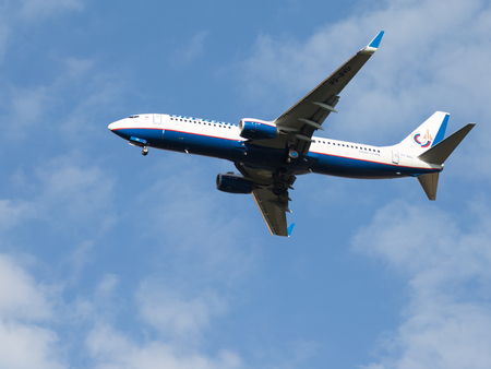spar: Moscow - August 6, 2015: Passenger Boeing 737-8LJ Orenburg Airlines landing at Domodedovo airport and the blue sky on Aug. 6, 2015, Moscow, Russia