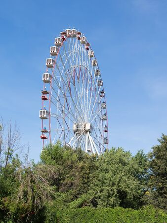 enea: Moscow - August 13, 2015: A large ferris wheel running in the park summer ENEA August 13, 2015, Moscow, Russia Editorial