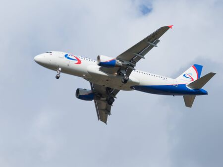 good weather: Moscow - August 6, 2015: A passenger Airbus A320-214 Ural Airlines is landing at Domodedovo airport and good weather August 6, 2015, Moscow, Russia
