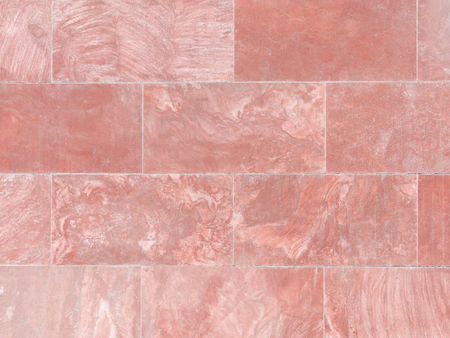 light streaks: beautiful red marble with dark and light streaks on the wall of stacked blocks
