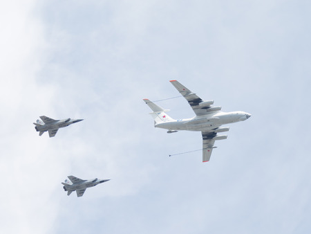 spar: Moscow - May 9, 2015: The IL-78 produces double aerial refueling MiG-31 in the sky over Red Square May 9, 2015, Moscow, Russia Editorial