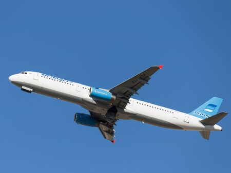 spar: Moscow - August 20, 2015: Beautiful blue and white Airbus A321-231 passenger aircraft Kolavia takes off at a Russian airport Domodedovo against the blue sky on Aug. 20, 2015, Moscow, Russia