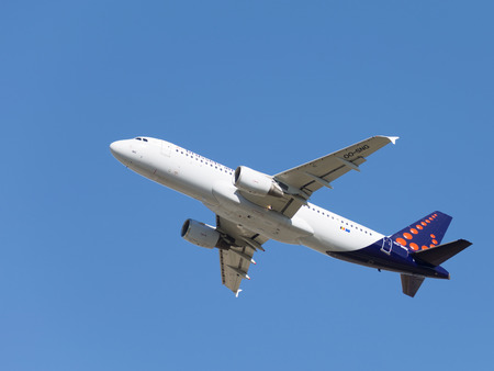 spar: Moscow - August 20, 2015: White passenger aircraft Airbus A320-214 Brussels Airlines orange circles on a blue tail take off at the airport Domodedovo against the blue sky on Aug. 20, 2015, Moscow, Russia Editorial