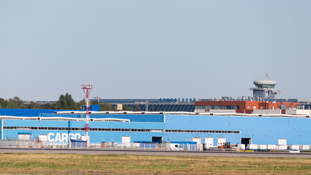 runways: Moscow - August 6, 2015: Cargo Terminal and control tower at the airport Domodedovo and runways August 6, 2015, Moscow, Russia