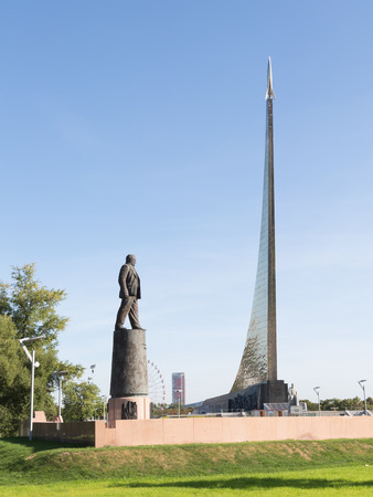 astronautics: Moscow - August 24, 2015: High silver Monument to the Conquerors of Space and the monument to Sergei Korolyov in the early morning in the summer of 24 August 2015, Moscow, Russia Editorial