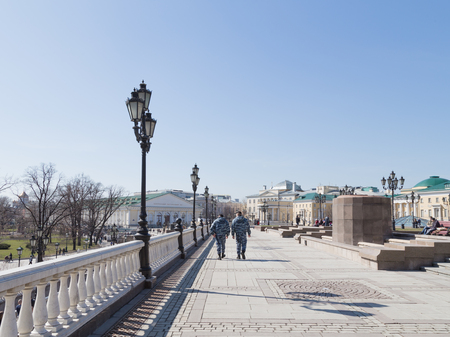 policing: Moscow - April 12, 2015: Police to maintain order in the area and people and tourists stroll on a beautiful Manezh Square April 12, 2015, Moscow, Russia Editorial