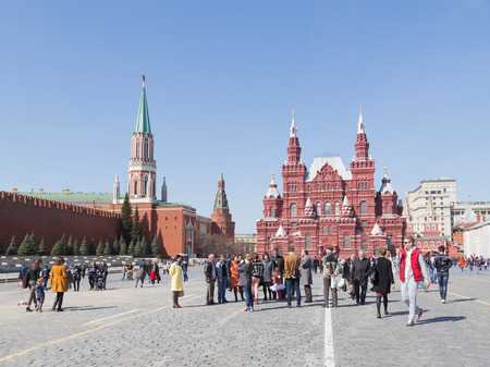 good weather: Moscow - April 12 2015: A lot of people and tourists walk from the Kremlin on the Red Square in good weather in the spring of April 12, 2015, Moscow, Russia