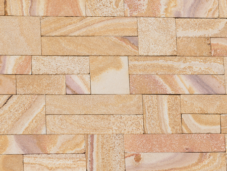 bevel: artificial stone unusual beige sandstone simulated in porous concrete blocks painted with bevel and laid brickwork