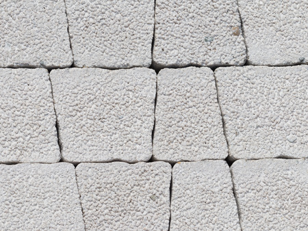 uneven edge: Decorative gray concrete blocks trapezoidal shape with rough seams